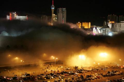 A cloud of dust from the Stardust hotel-casino rolls over spectators and media in the Frontier ...