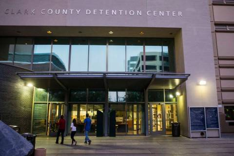 People walk outside of the Clark County Detention Center in downtown Las Vegas. (Chase Stevens/ ...