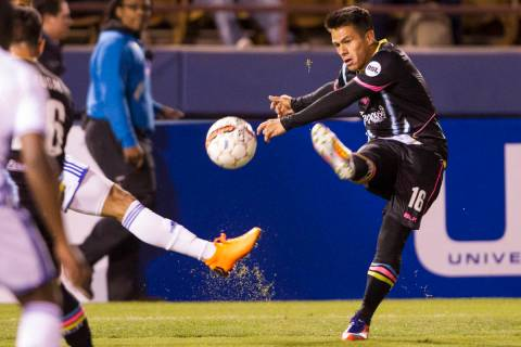 Las Vegas Lights FC's Marcelo Alatorre (16) kicks a pass against Reno 1868 FC during the ...