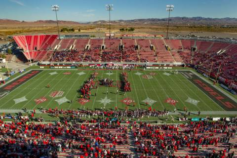Former UNLV football players come together on the field for the coin toss versus the San Jose S ...