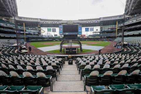 FILE - In this Friday, July 31, 2020, file photo, fan cutouts sit in seats behind home plate at ...