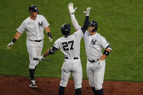 New York Yankees' Aaron Judge, right, celebrates his two-run home run with Giancarlo Stanton (2 ...