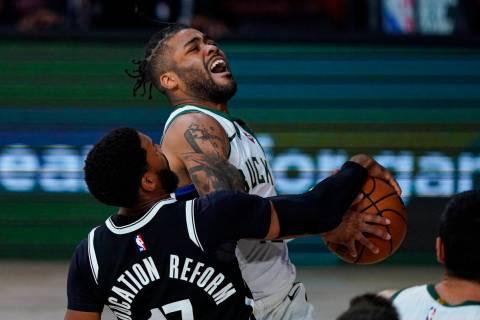 Milwaukee Bucks guard Frank Mason III (15) is fouled as he shoots by Brooklyn Nets guard Garret ...