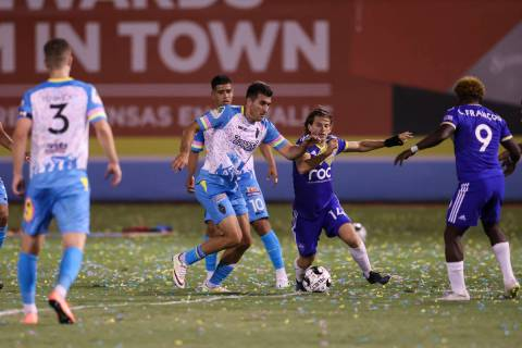 Mart'n Del Campo, center left, battles for the ball against Reno 1868 FC's Emilio Ycaza durin ...