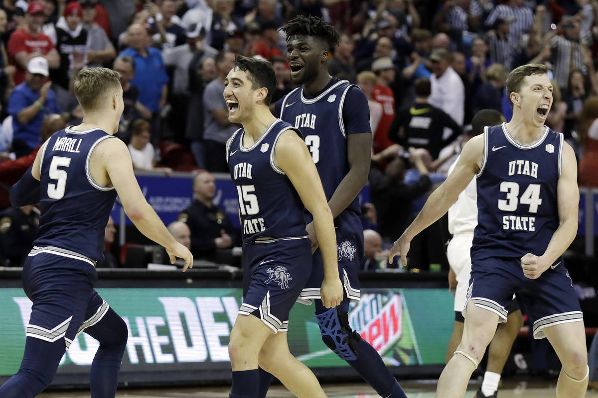 Utah State reacts after Sam Merrill (5) sunk a 3-point basket with seconds remaining in the sec ...