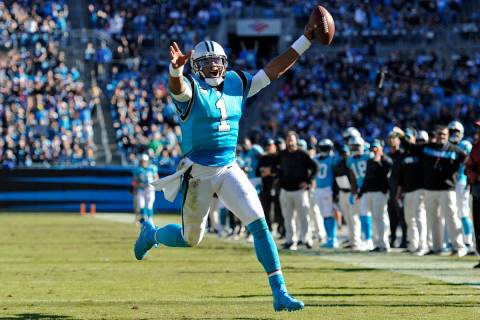 Carolina Panthers' Cam Newton (1) runs for a touchdown against the Baltimore Ravens in the seco ...