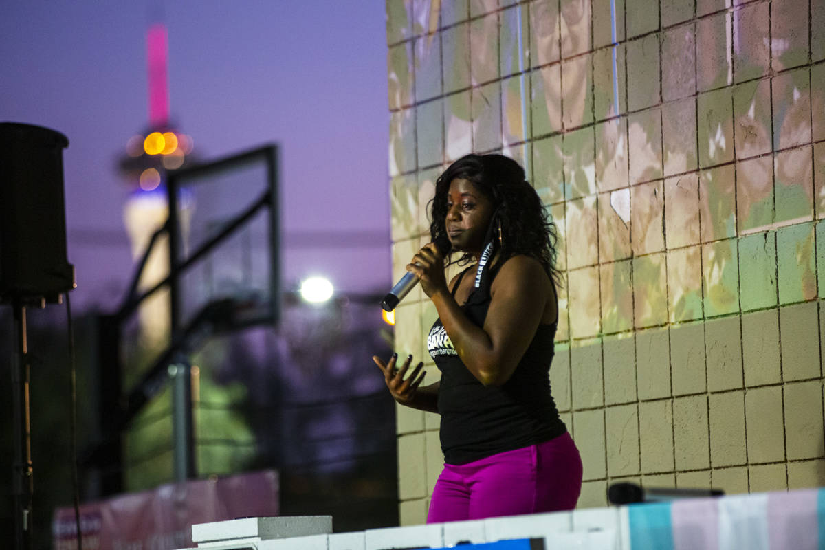 Nicole Williams, of Vegas Urban Pride, speaks during a candlelight vigil, in remembrance of the ...
