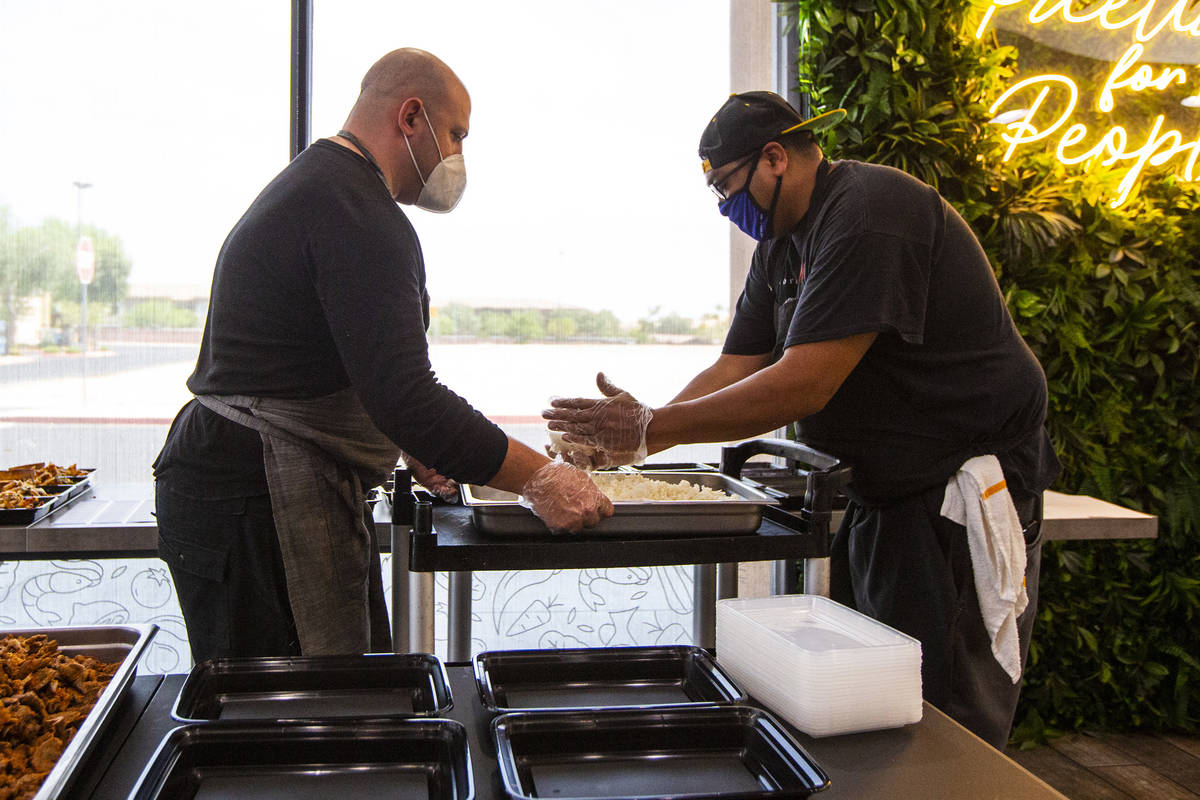 Jeffrey Weiss, left, and Paras Shah, co-owners and co-chefs at Valencian Gold, package meals fo ...