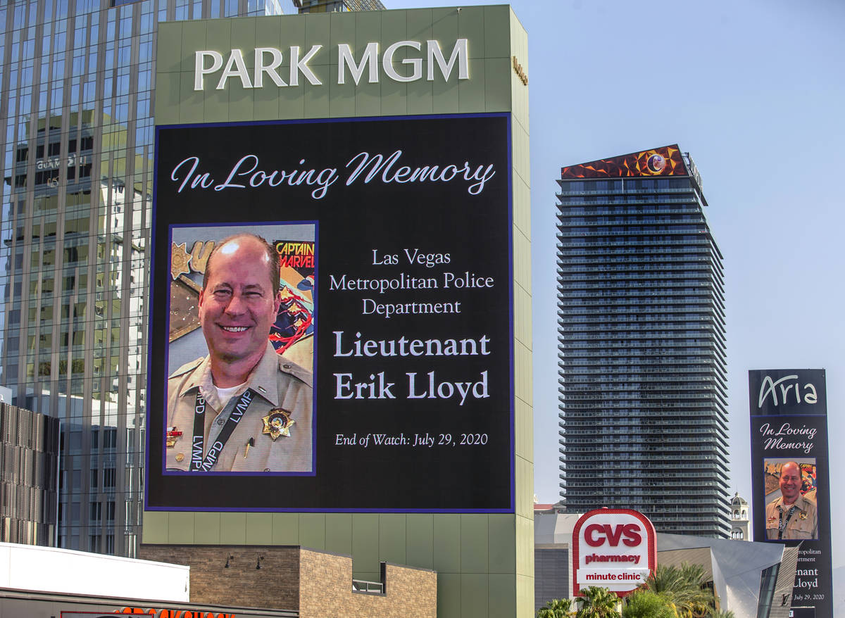 The marquee at Park MGM recognizes the passing of Metro Lt. Erik Lloyd as his funeral processio ...