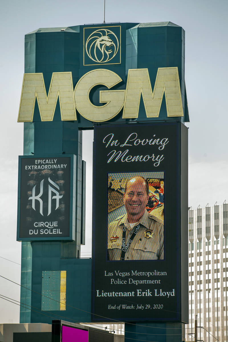 The marquee at the MGM recognizes the passing of Metro Lt. Erik Lloyd as his funeral procession ...