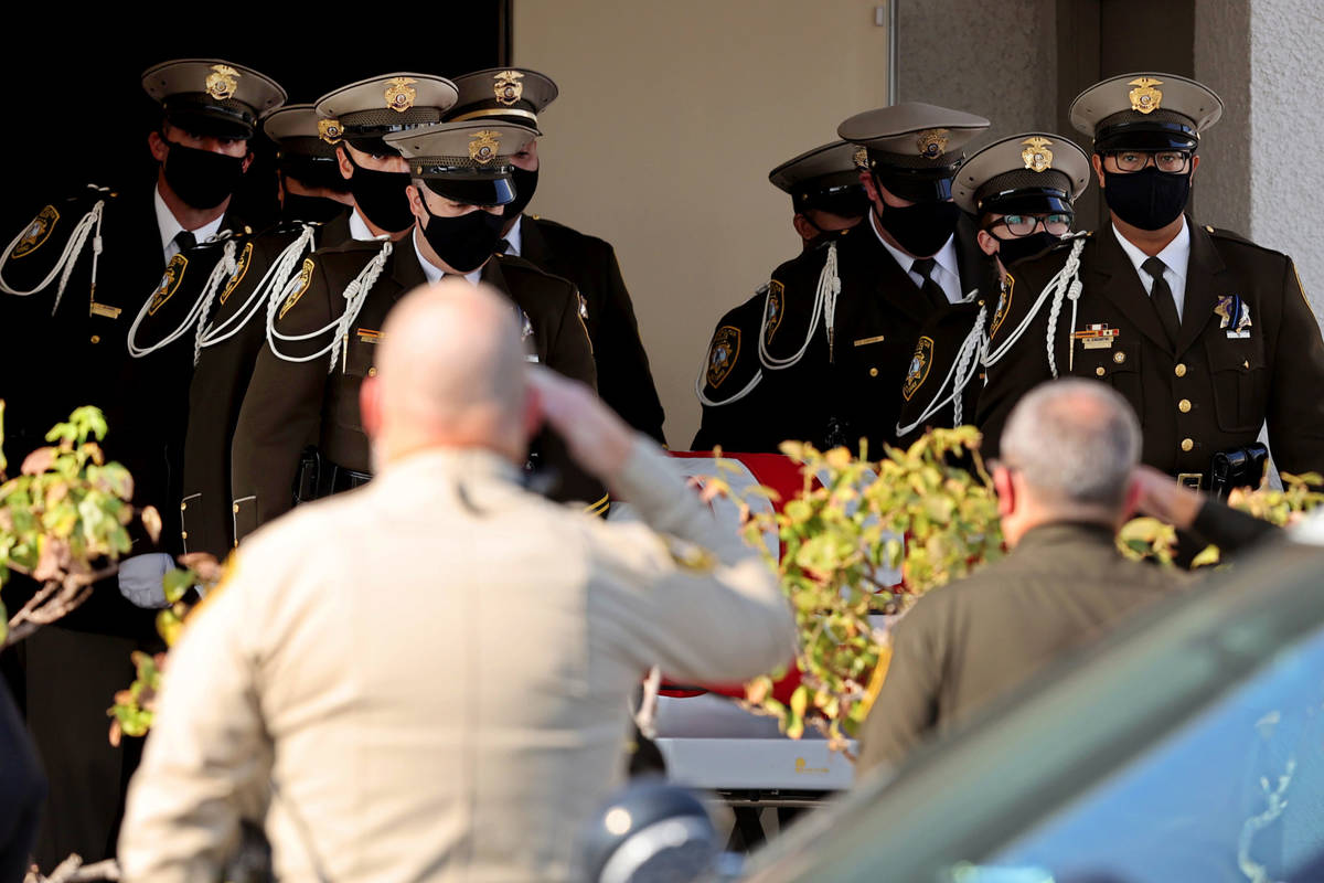 Honor guard members load the casket of Metropolitan Police Department Lt. Erik Lloyd at Palm Do ...