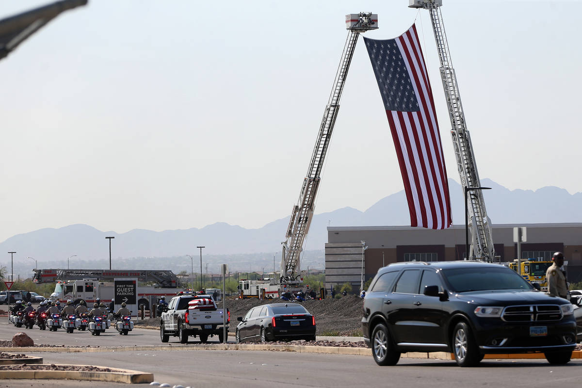The funeral procession for Lt. Erik Lloyd arrives to Central Christian Church in Henderson, Wed ...