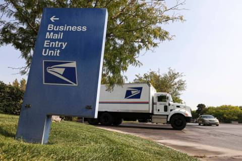 A truck departs from the U.S. Postal Service center at 1001 E. Sunset Road in Las Vegas on Thur ...