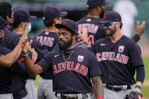 Cleveland Indians center fielder Delino DeShields greets teammates after their 8-5 over the Det ...