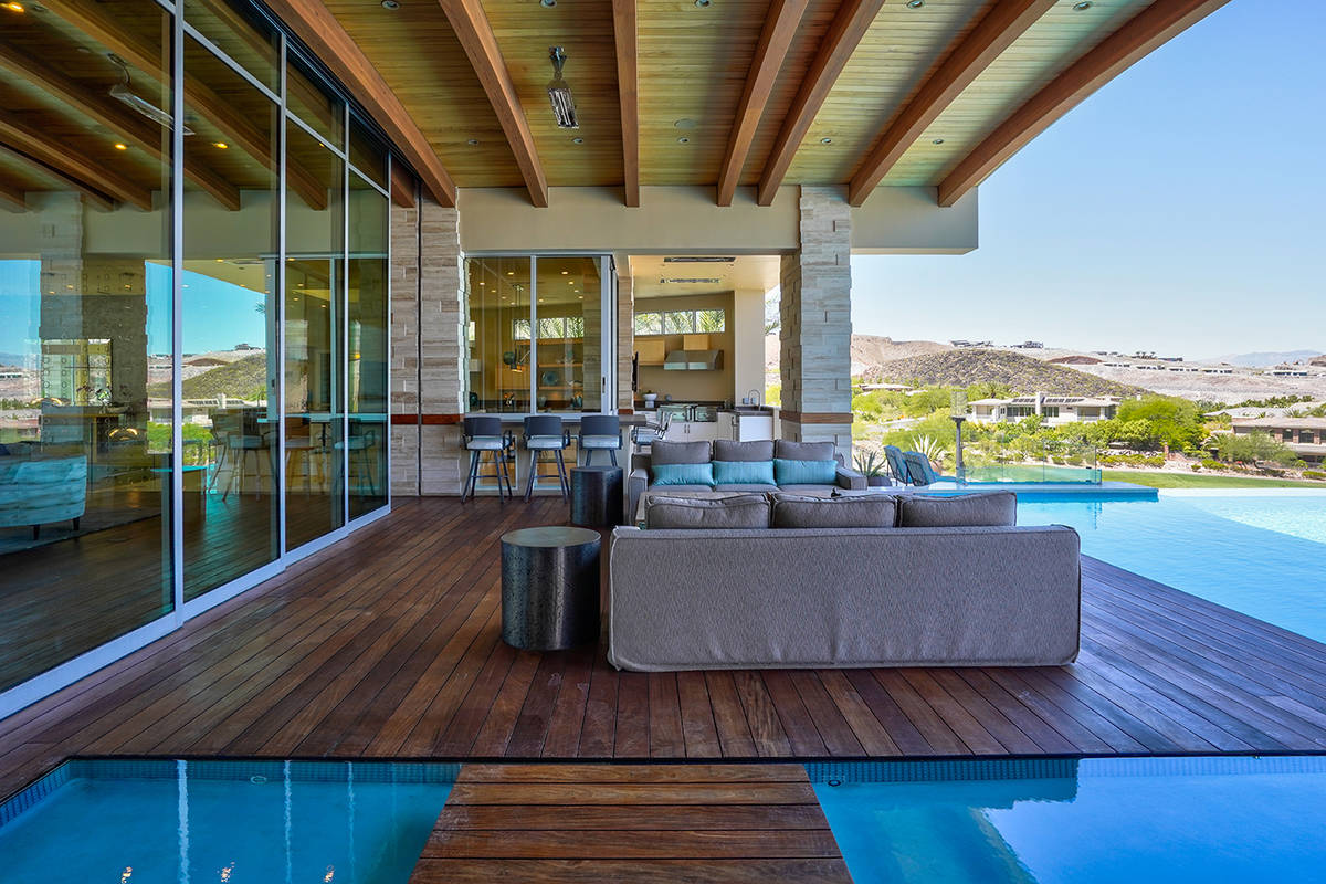 The pool surrounds the backyard patio. (Sun West Custom Homes)