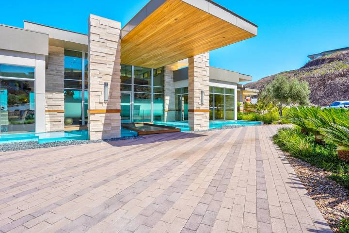 The MacDonald Highlands home measures 7,928 square feet with four bedrooms, six bathrooms and a ...