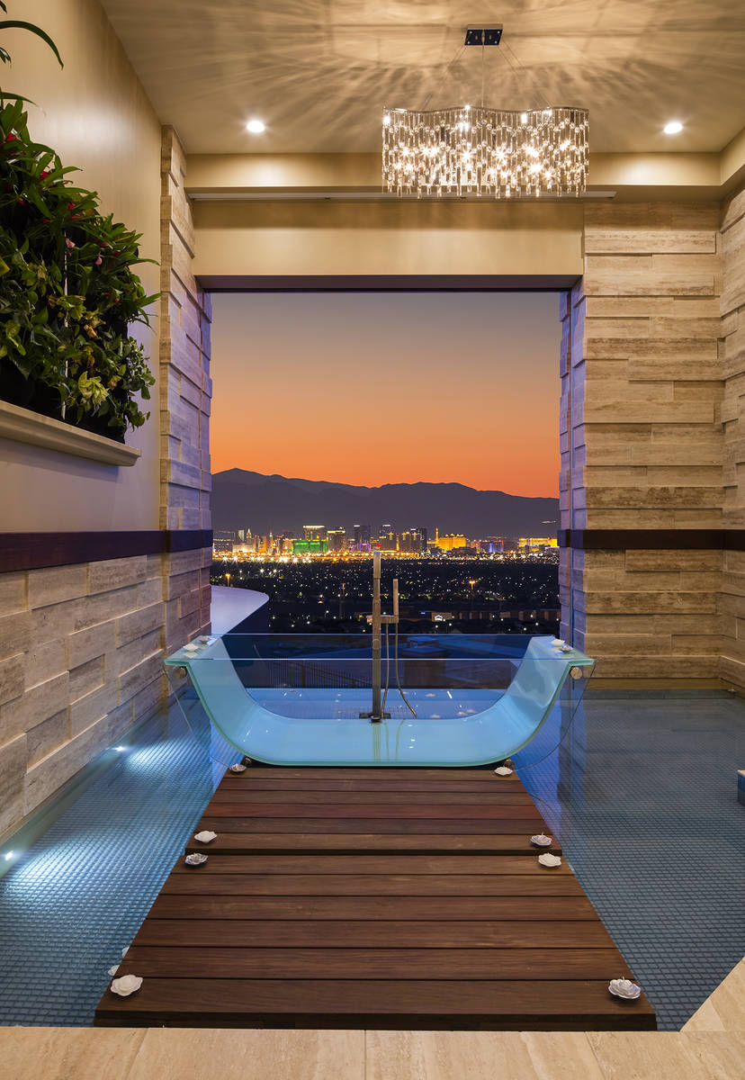 The Henderson home's master bedroom has a unique bath that has views of the Las Vegas Strip. (S ...