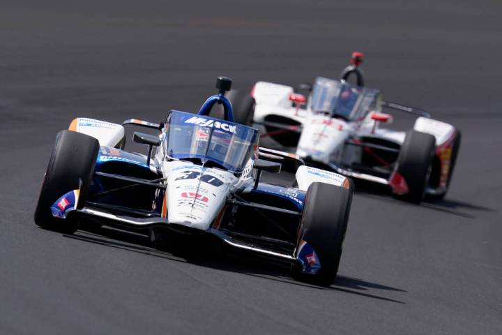 Takuma Sato, of Japan, leads Marco Andretti into turn one during the Indianapolis 500 auto race ...