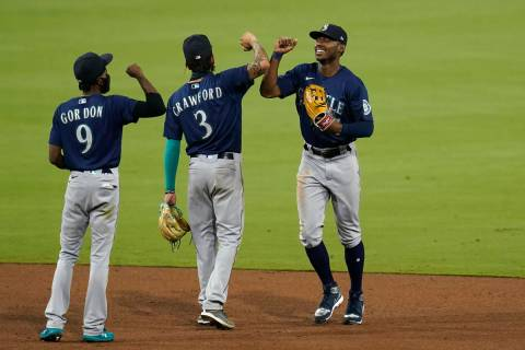 Seattle Mariners center fielder Kyle Lewis, right, celebrates with teammate shortstop J.P. Craw ...