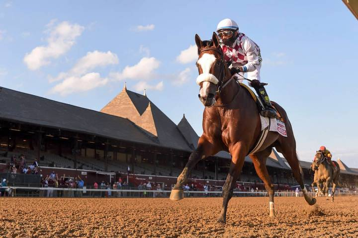 In a photo provided by the NYRA, Tiz the Law crosses the finish line to win the Travers Stakes ...