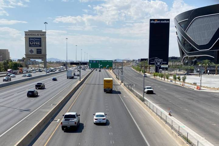 Vehicles travel on Interstate 15 near Allegiant Stadium on Aug. 28, 2020. (Mick Akers/Las Vegas ...