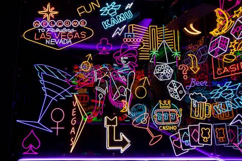 A room filled with neon signs at Kamu Karaoke at the Grand Canal Shoppes at The Venetian in Las ...
