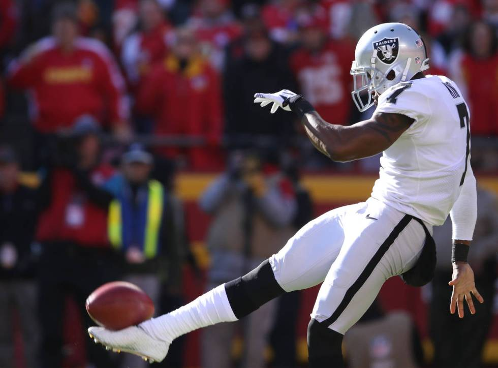 Oakland Raiders punter Marquette King (7) punts the football during the first half of a NFL gam ...