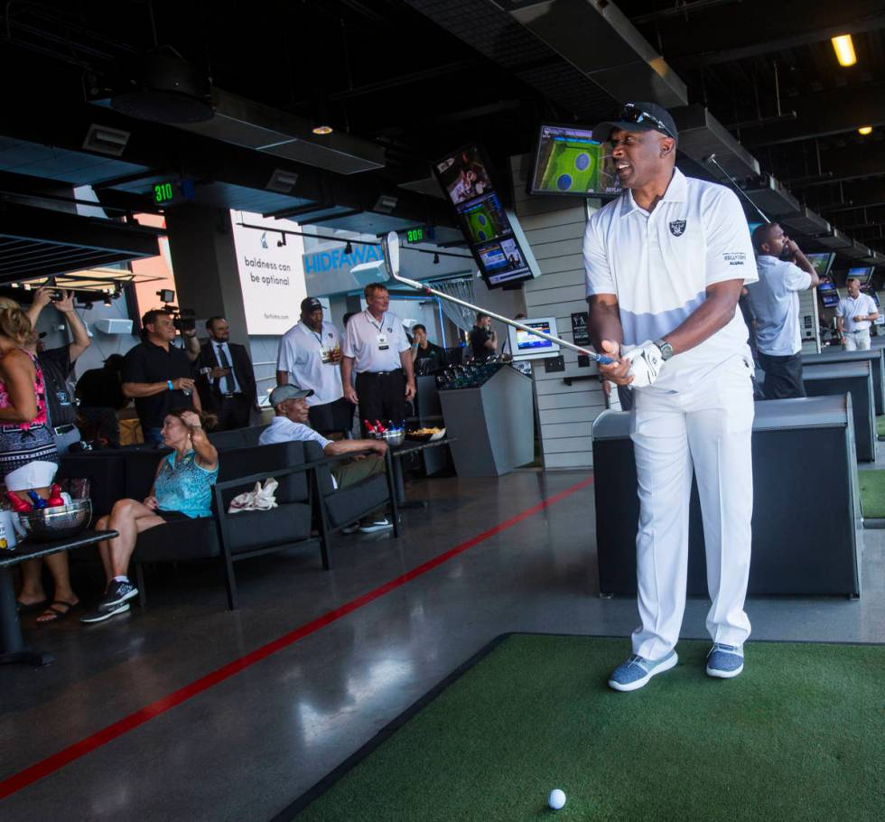 Former Oakland Raiders wide receiver Tim Brown gets ready to swing during the Raiders Foundatio ...