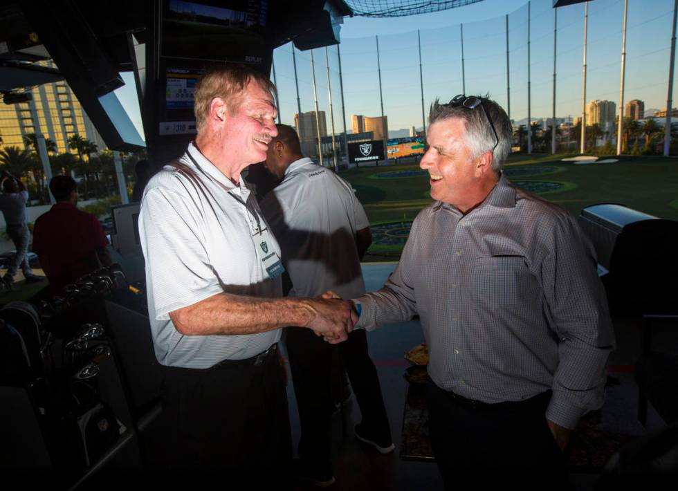 Former Oakland Raiders linebacker Ted Hendricks, left, mingles with attendees during the Raider ...