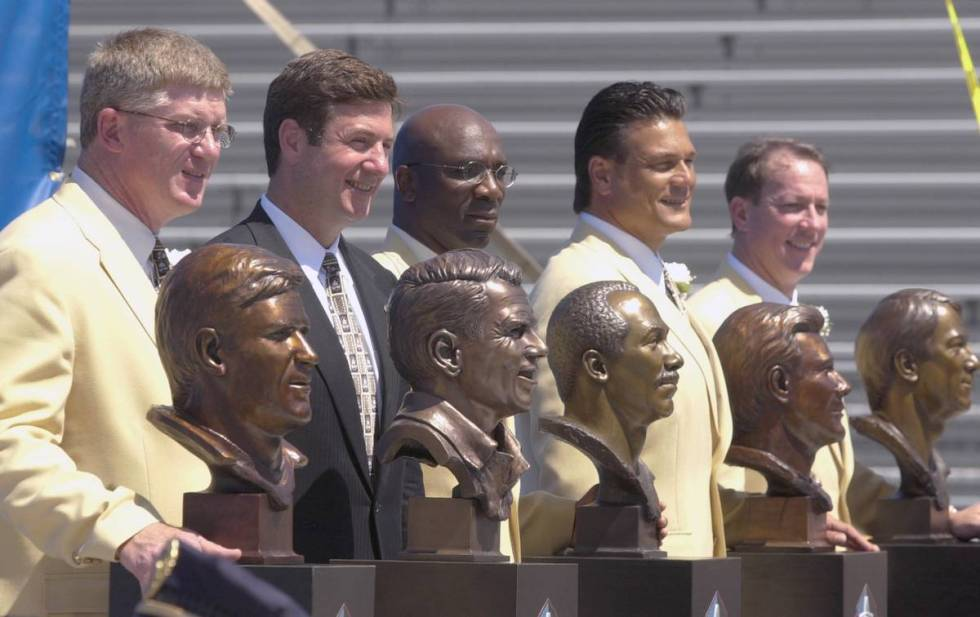 The Class of 2002 pose with their busts after enshrinement into the Pro Football Hall of Fame i ...