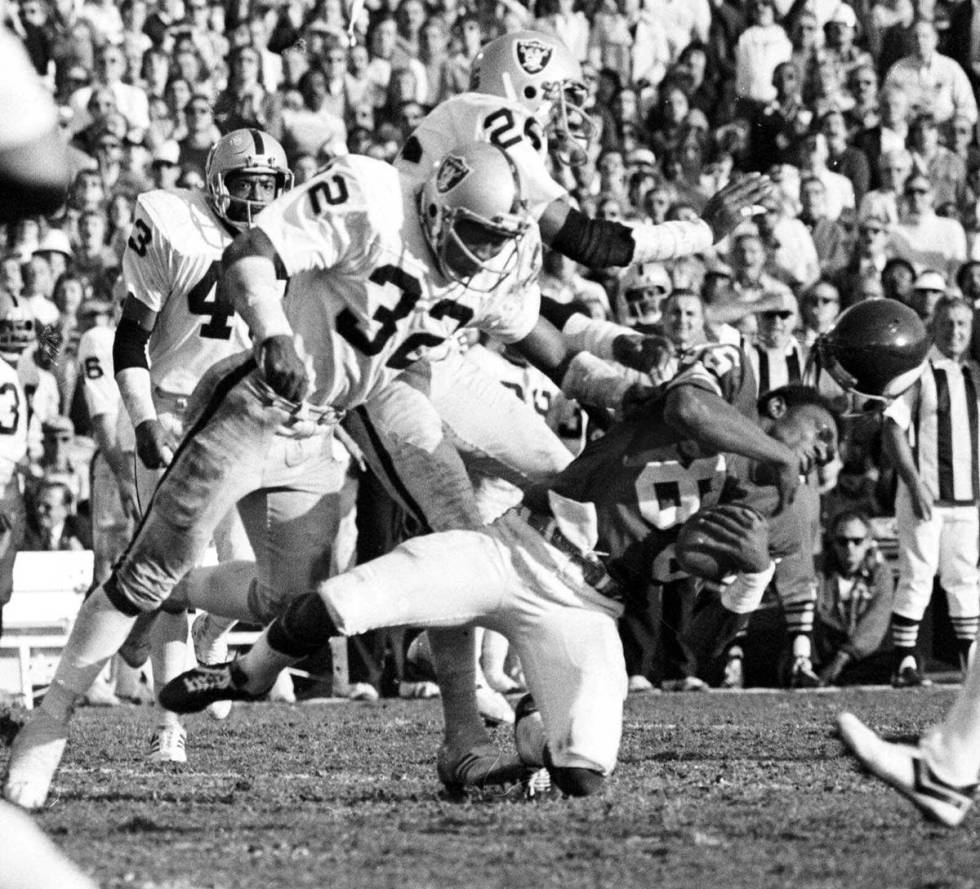 FILE*** This Jan. 9, 1977 file photo shows Minnesota Vikings wide receiver Sammy White losing ...