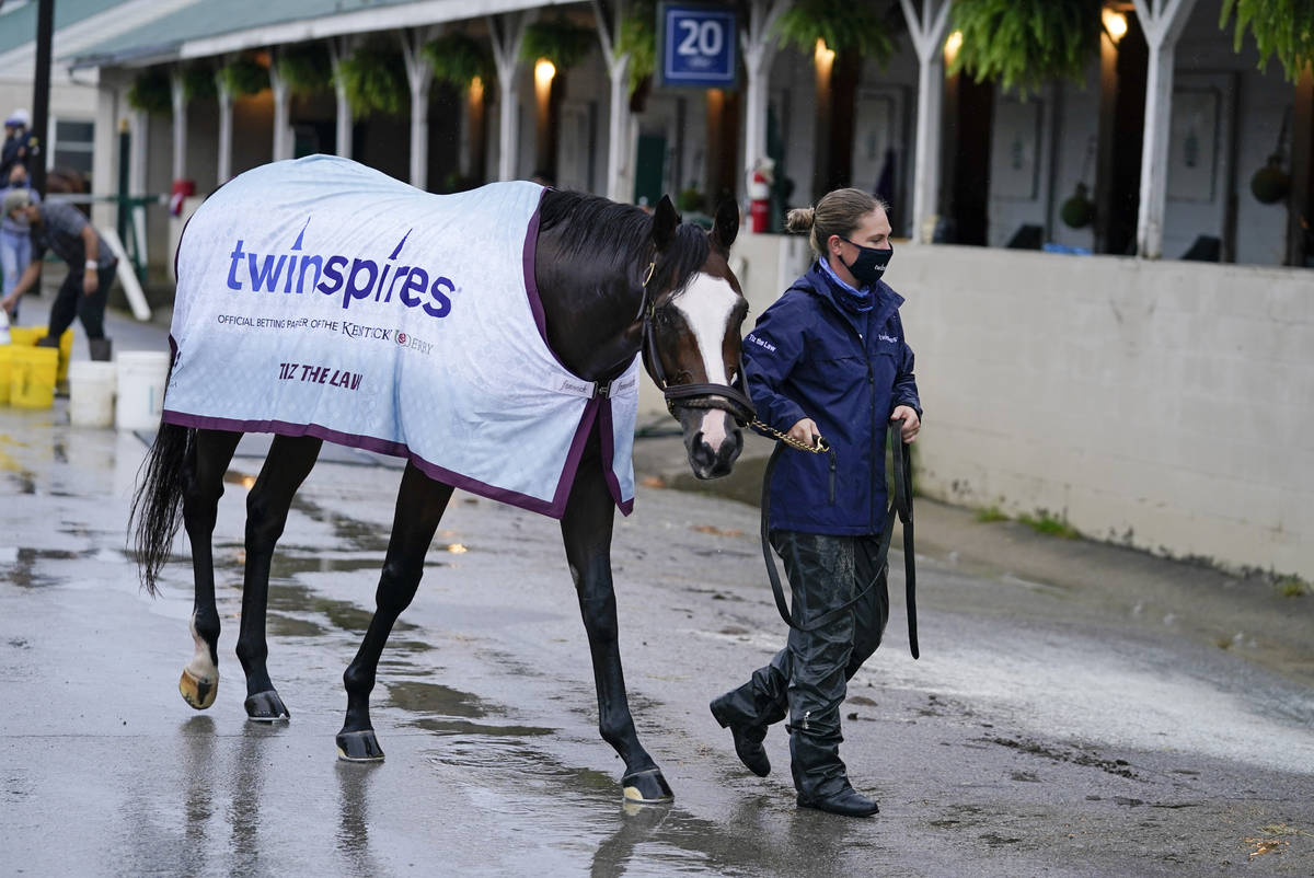 Kentucky Derby entry Tiz the Law is lead back to a stall following a bath at Churchill Downs, T ...