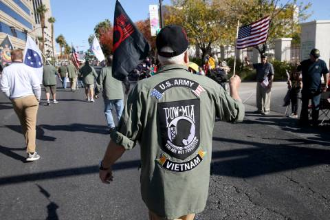 Army veteran Steve Sorensen, 70, of Alden, Minn., marches in the Veterans Day Parade in downtow ...