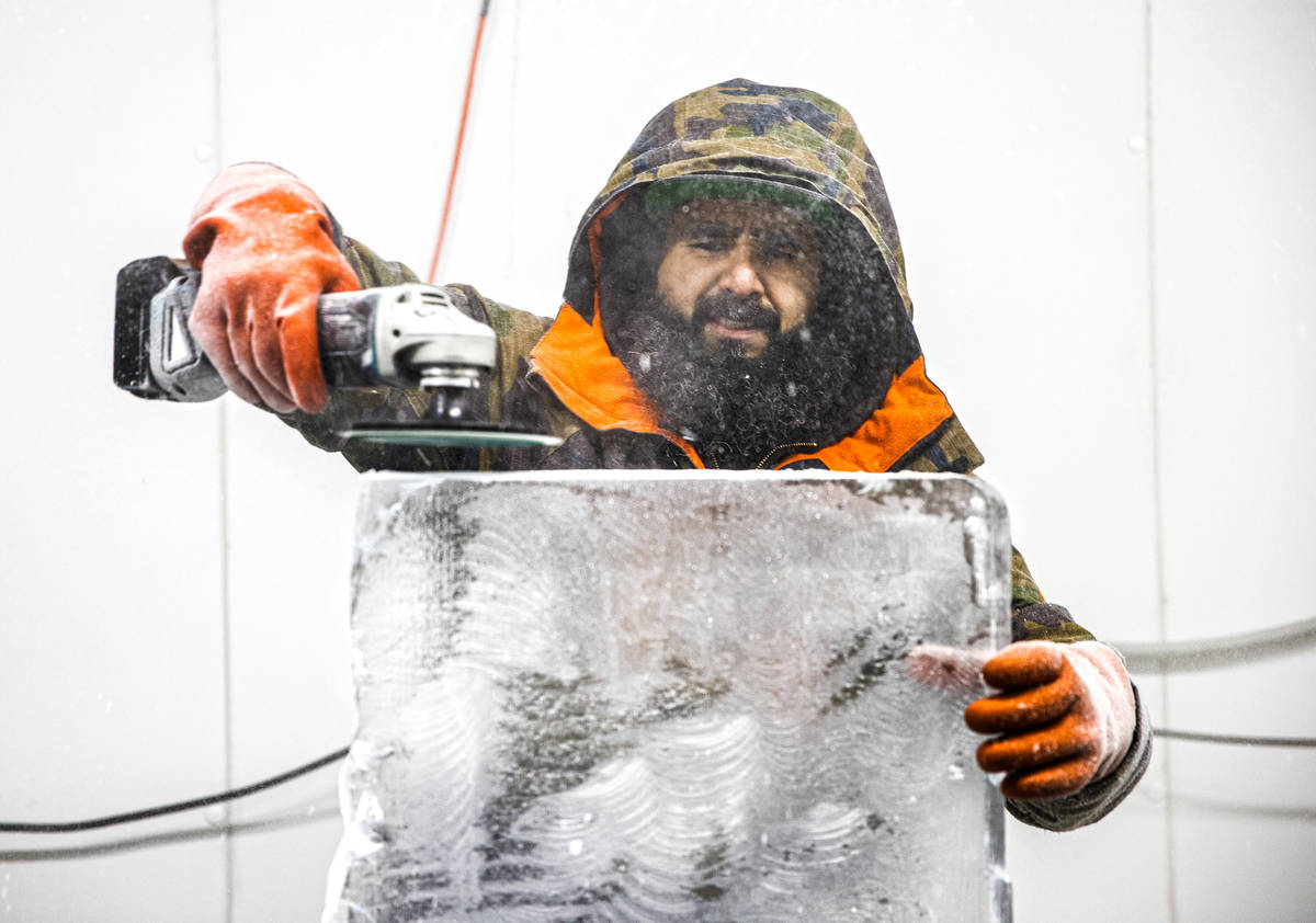 "Marco Villarreal, known as ""Vegas Ice Man,"" works on an ice sculpture on Tuesday, Sep ..."