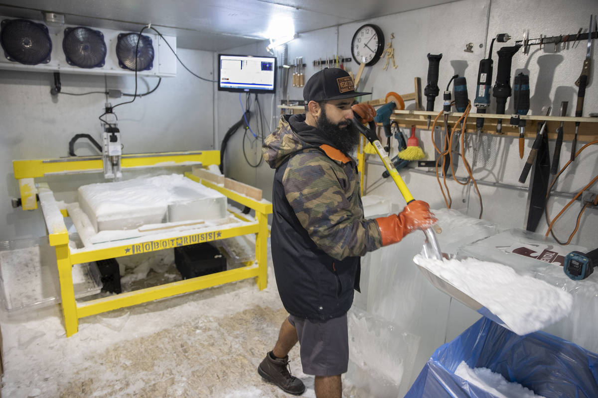 "Marco Villarreal, known as ""Vegas Ice Man,"" shovels freshly made snow on Tuesday, Sep ..."