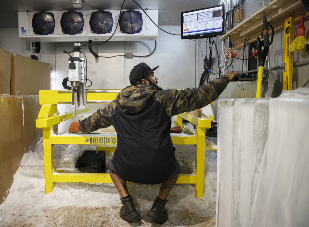 "Marco Villarreal, known as ""Vegas Ice Man,"" cuts a fresh block of ice before beginnin ..."