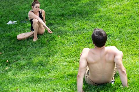 Natalie Kleinman, left, and Tyler Bryce, right, practice yoga despite an excessive heat warning ...