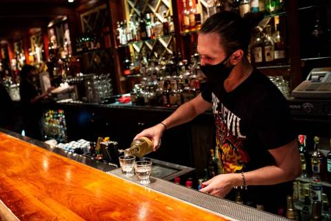 Nicky Cianella prepares drinks just before last call at The Griffin on Fremont Street in downto ...