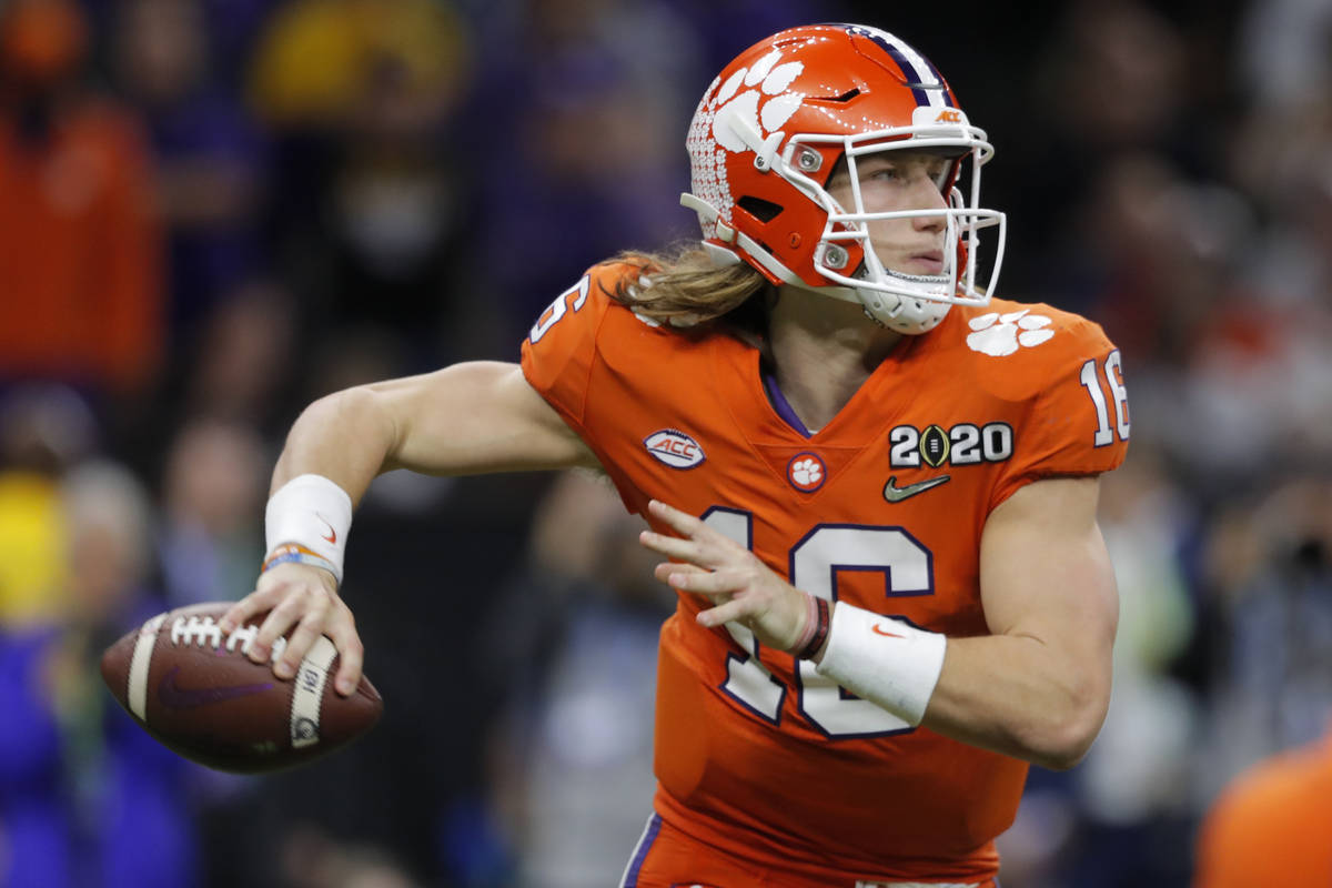 FILE - In this Jan. 13, 2020, file photo, Clemson quarterback Trevor Lawrence looks to pass aga ...