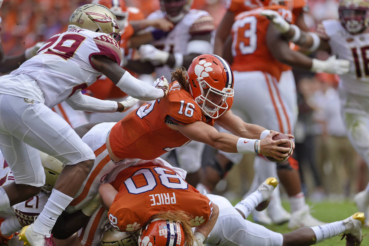 FILE - In this Oct. 12, 2019, file photo, Clemson quarterback Trevor Lawrence (16) stretches ou ...