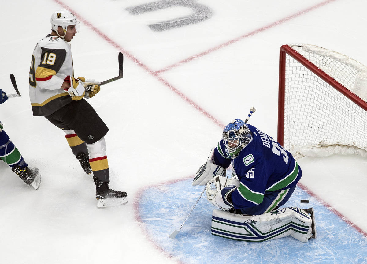Vancouver Canucks goalie Thatcher Demko (35) makes a save against Vegas Golden Knights' Reilly ...