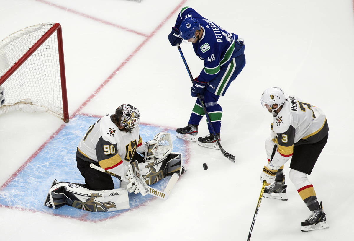 Vancouver Canucks' Elias Pettersson (40) is stopped by Vegas Golden Knights goalie Robin Lehner ...