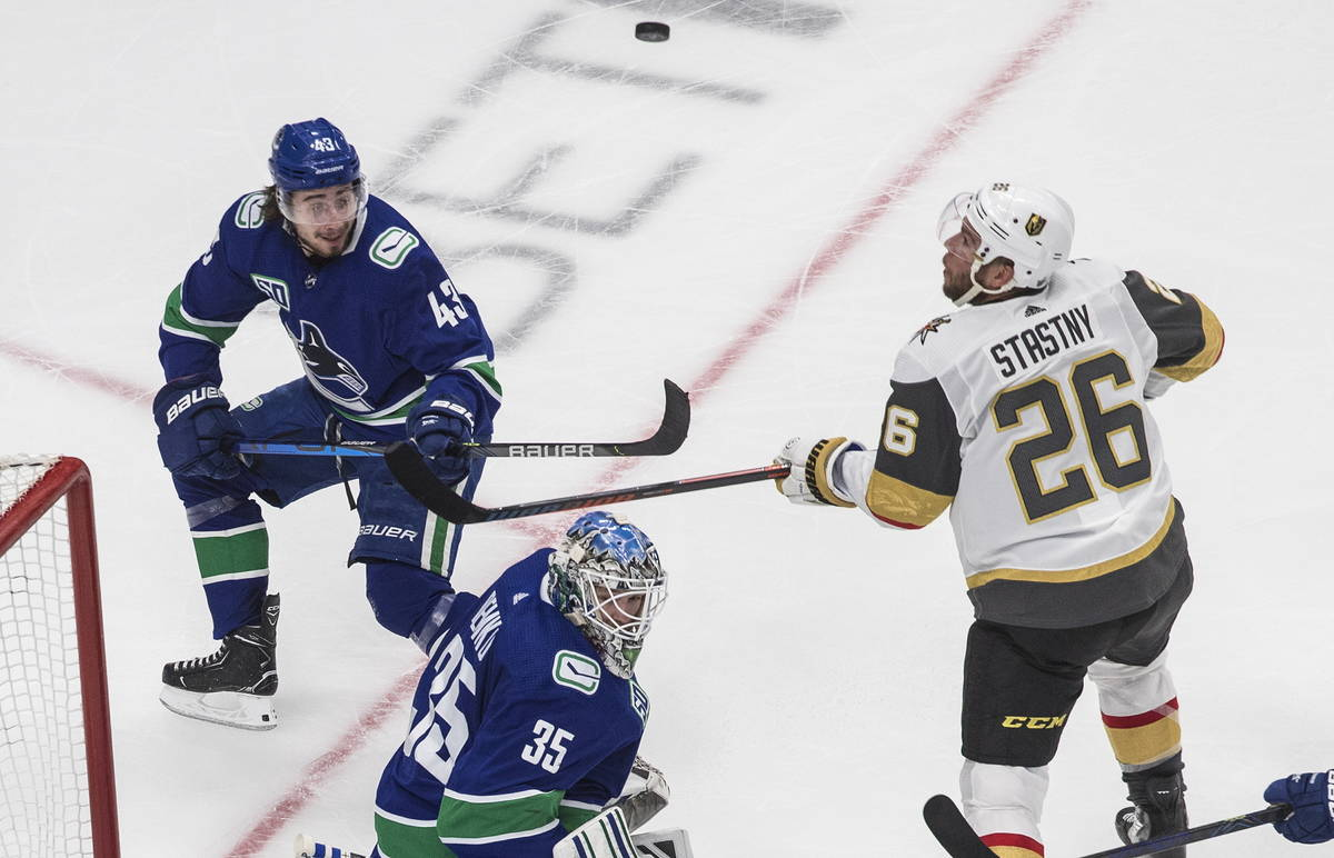 Vancouver Canucks goalie Thatcher Demko (35), Vegas Golden Knights' Paul Stastny (26) and Canuc ...