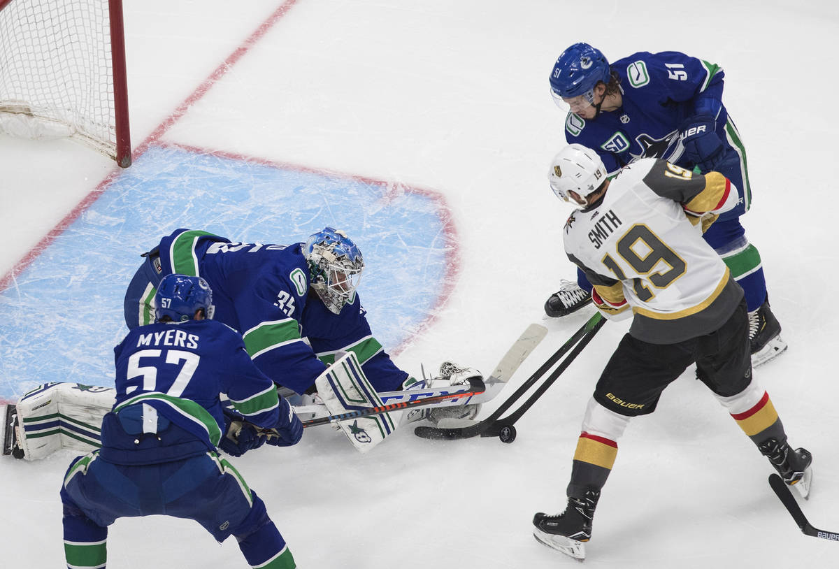 Vancouver Canucks goalie Thatcher Demko (35) makes a save on Vegas Golden Knights' Reilly Smith ...