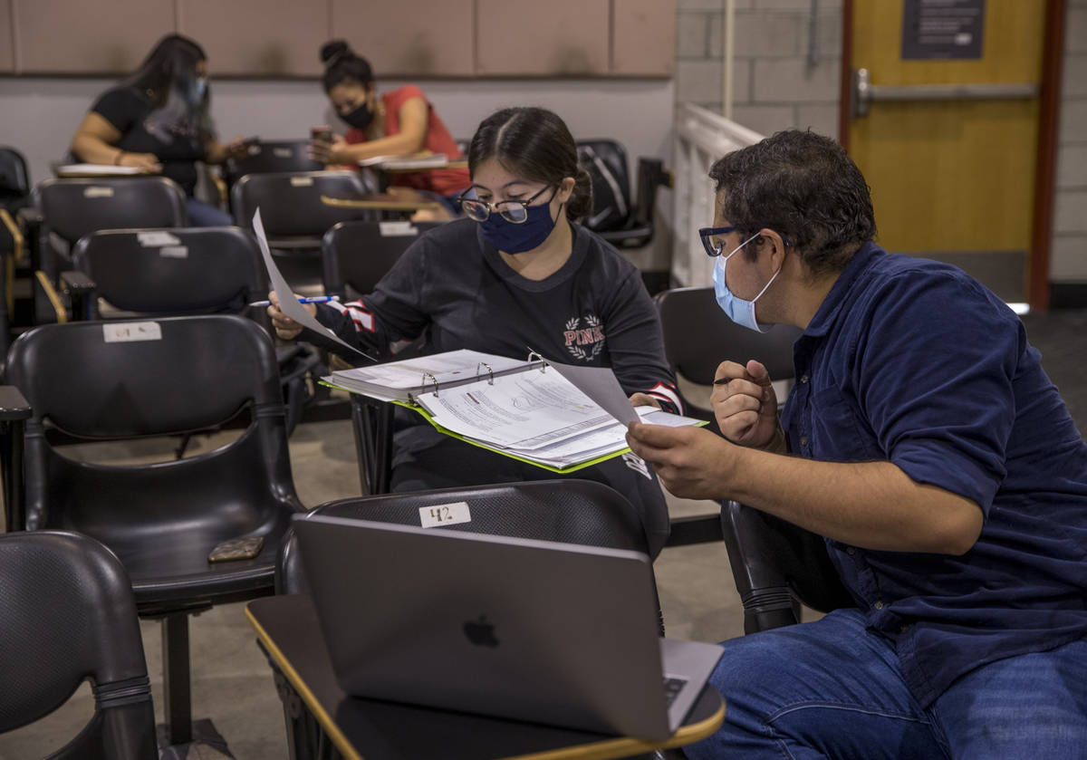 "UNLV pre-nursing freshman Jorge ""Fabian"" Trejo-Ibarra, right, works on a problem with fellow st ..."