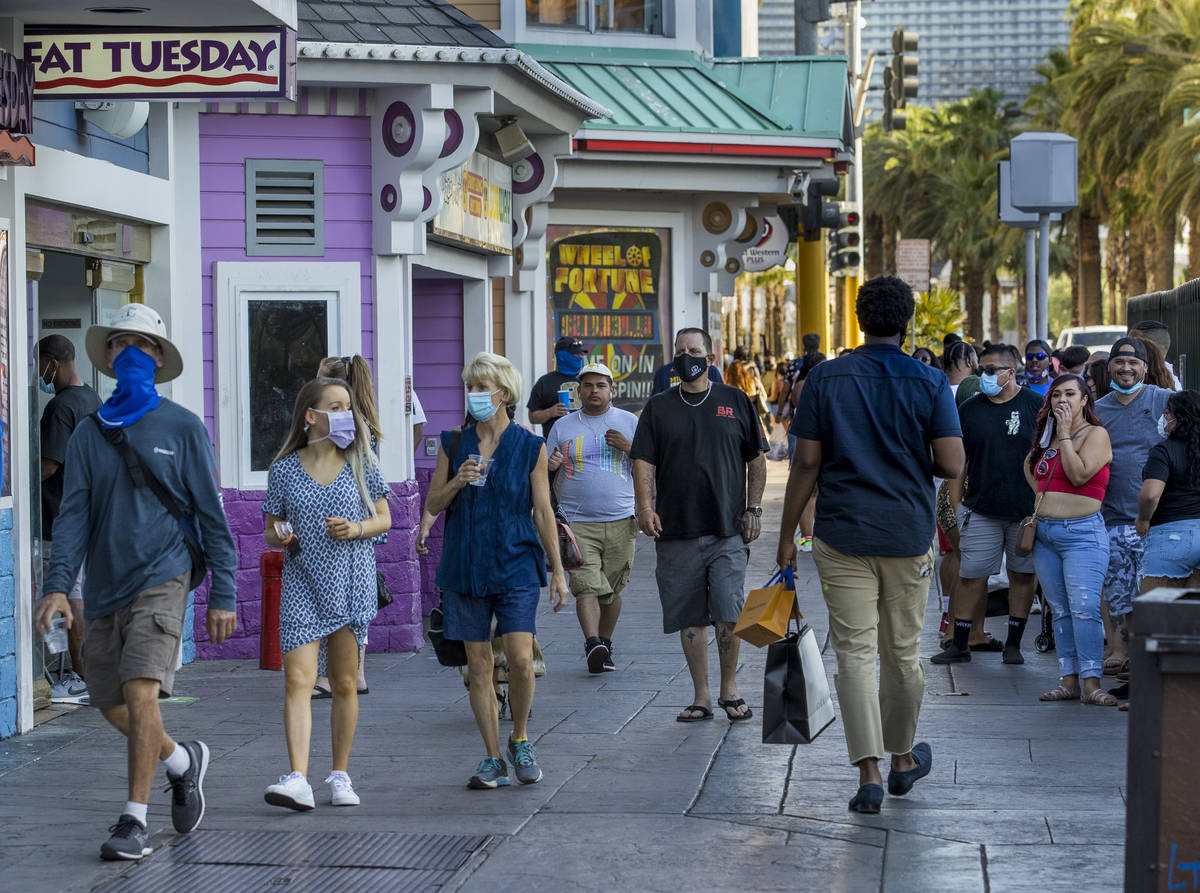 Visitors wander past and in line at Fat Tuesday along the Strip on Friday, August 7, 2020, in L ...
