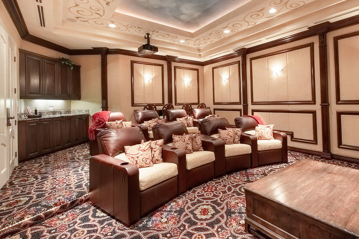 Elite Homes The home has an entertainment level with a home theater and game room.