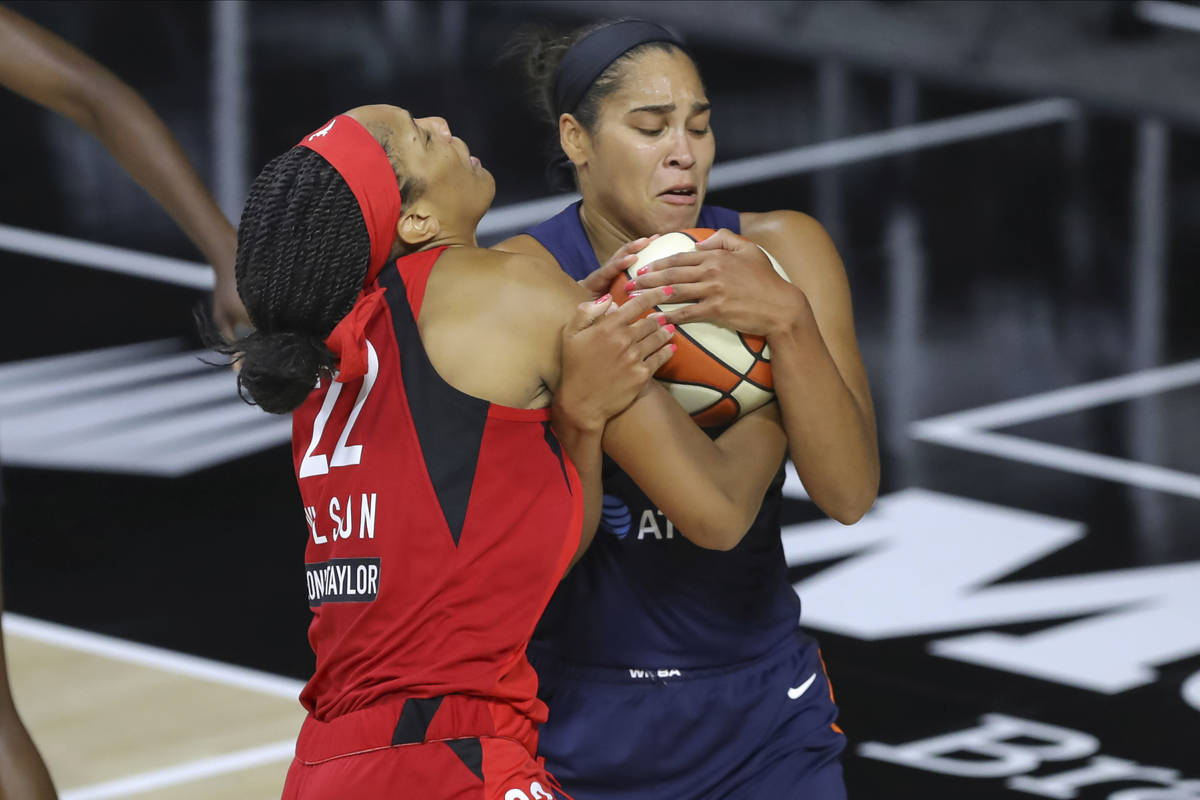 Connecticut Sun's Brionna Jones, right, steals the ball from Las Vegas Aces' A'ja Wilson during ...
