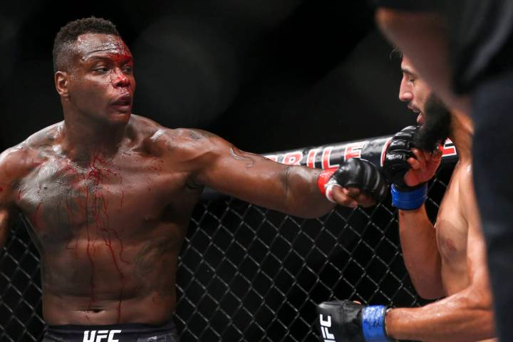 Ovince Saint Preux, left, fights Dominick Reyes during their light heavyweight bout at UFC 229 ...
