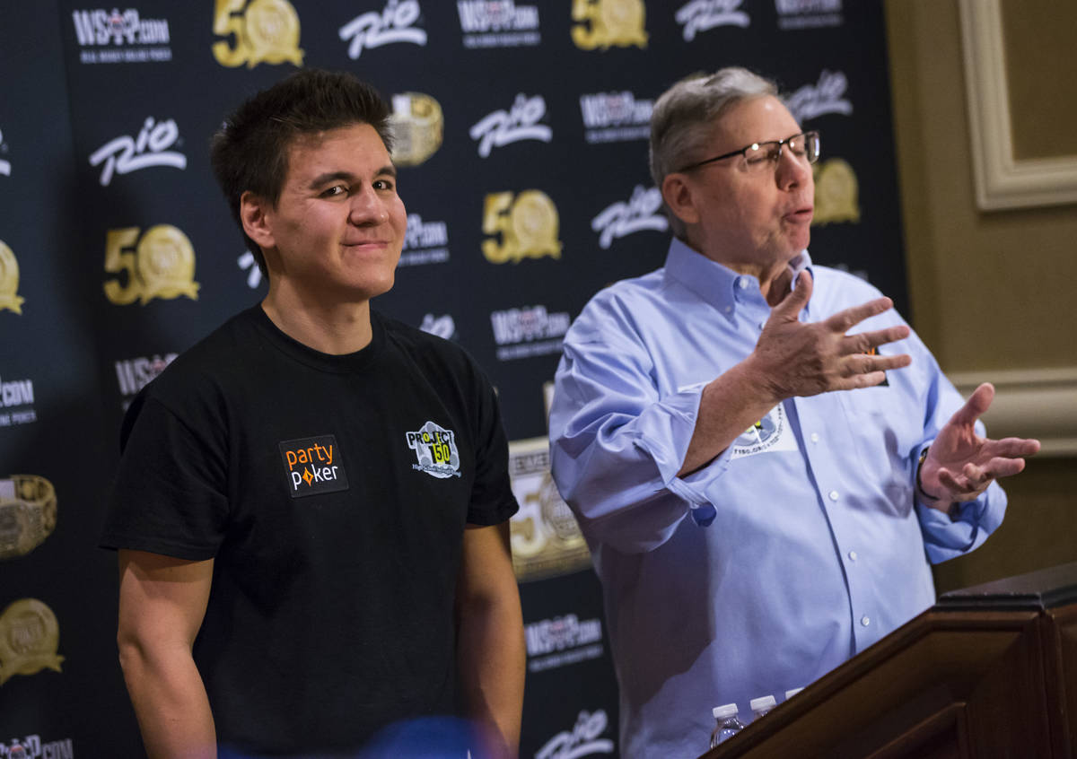 """Las Vegas resident and """"Jeopardy!"""" sensation James Holzhauer, left, looks on as Poker Hall of F ..."""